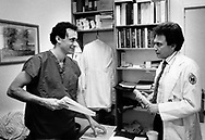 Dr. Michael Glick (left) speaks with another doctor in the office in 1989 at the Infectious Disease Clinic at Temple University in Philadelphia, Pennsylvania. The Infectious Disease Clinic at Temple University, was established in 1988 by Dr. Glick to treat people with HIV from throughout the region. (Photo by William Thomas Cain/Cain Images)