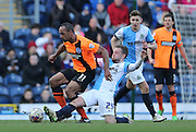 Chris O'Grady, Brighton striker and Jay Spearing, Blackburn Rovers midfielder during the Sky Bet Championship match between Blackburn Rovers and Brighton and Hove Albion at Ewood Park, Blackburn, England on 21 March 2015.