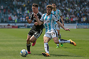 Martin Cranie (Huddersfield Town) and Sergi Canos (Brentford) during the Sky Bet Championship match between Huddersfield Town and Brentford at the John Smiths Stadium, Huddersfield, England on 7 May 2016. Photo by Mark P Doherty.