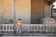 Boy with garlic in Velasco, Holguin, Cuba.