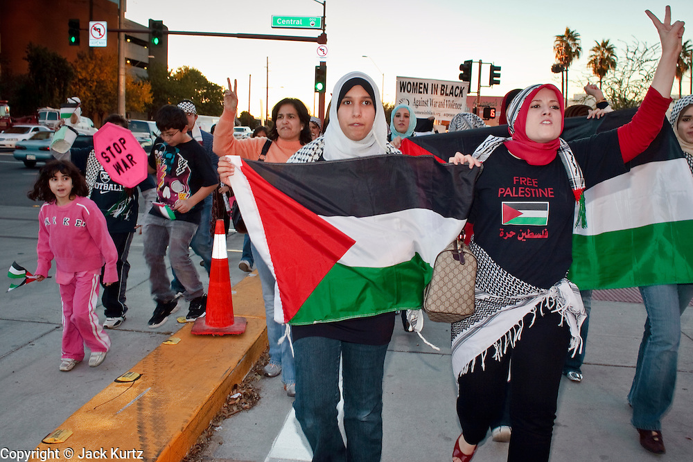 30 DECEMBER 2008 -- PHOENIX, AZ: People march through the streets of Phoenix, AZ, in support of Palestinian rights and in opposition to Israeli attacks on Gaza, Tuesday. About 200 people from a variety of human rights and peace activists organizations in Phoenix, AZ, marched in opposition to the Israeli attacks on Gaza and in favor of Palestinian rights on Tuesday, the fourth day of Israeli air strikes on Hamas facilities in Gaza. Photo by Jack Kurtz / ZUMA Press
