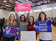 "Westbury, New York, USA. January 15, 2017. L-R, SUE MOLLER of Merrick, AMY BUDD of Bellmore, STEFANA MULLER of Babylon, and BETH MCMANUS of Seaford, the Administrators of Together We Will Long Island, TWWLI, are holding protest signs at the ""Our First Stand"" Rally against Republicans repealing the Affordable Care Act, ACA, taking millions of people off health insurance, making massive cuts to Medicaid, and defunding Planned Parenthood."