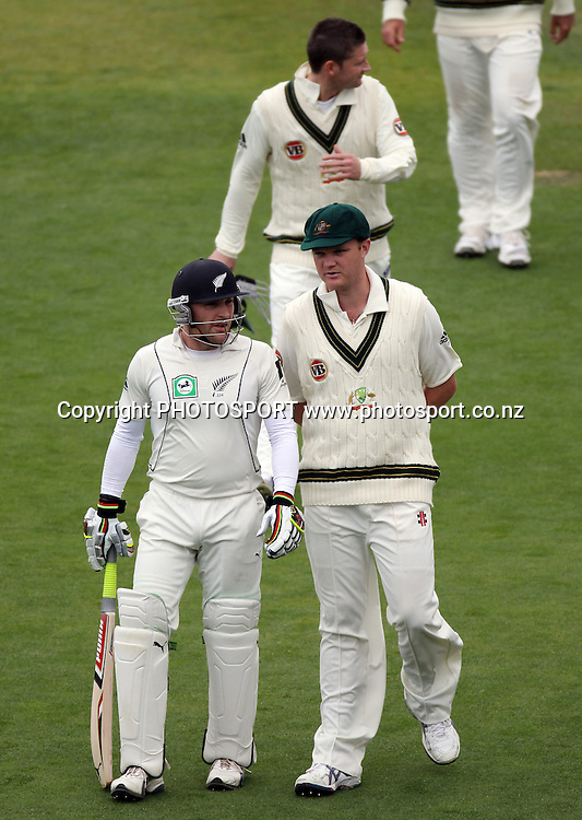 New Zealand batsman Brendon McCullum talks to Doug Bollinger as they leave the field for bad light.<br />