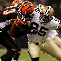 2009 August 14: New Orleans Saints defensive end Paul Spicer (95) works against Cincinnati Bengals offensive tackle Anthony Collins (73) during a preseason opener between the Cincinnati Bengals and the New Orleans Saints at the Louisiana Superdome in New Orleans, Louisiana.