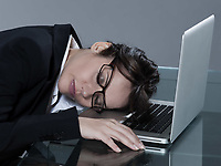 beautiful brunette business woman at her desk sleeping
