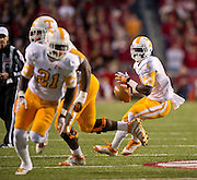 Nov 12, 2011; Fayetteville, AR, USA;  Tennessee Volunteers tailback Marlin Lane (4) looks to make a pass as wide receiver Da'Rick Rogers (21) runs a route during a game against the Arkansas Razorbacks at Donald W. Reynolds Razorback Stadium. Arkansas defeated Tennessee 49-7. Mandatory Credit: Beth Hall-US PRESSWIRE