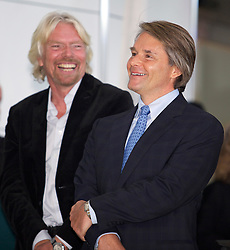 Virgin Group Founder Sir Richard Branson, (L) , laughs with David Cush, Virgin America president and chief executive at the opening of new Terminal 2 at San Francisco International Airport.  The 640,000- square-foot Terminal is expected to be the first LEED Gold-certified terminal in the U.S.