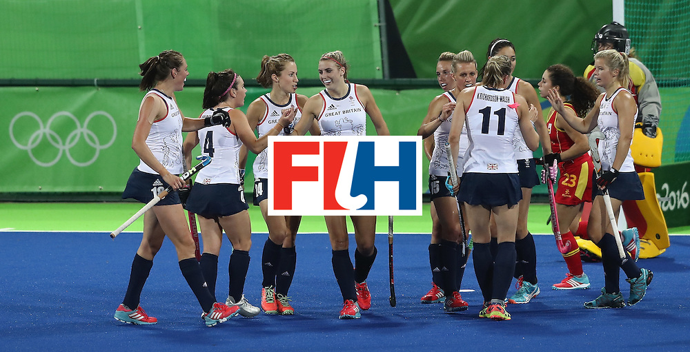 RIO DE JANEIRO, BRAZIL - AUGUST 15:  Lily Owsley (C) of Great Britain celebrates with team mates after scoring their third goal during the Women's quarter final hockey match between Great Britain and Spain on Day10 of the Rio 2016 Olympic Games held at the Olympic Hockey Centre on August 15, 2016 in Rio de Janeiro, Brazil.  (Photo by David Rogers/Getty Images)