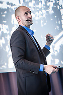 Event Photography images from Tivoli Congress Center in Copenhagen. The client was Basware, based in Finland<br /> <br /> A keynote speaker delivers an address.<br /> <br /> © Event Photographer in Copenhagen Matthew James