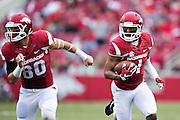 FAYETTEVILLE, AR - OCTOBER 31:  Jared Cornelius #1 runs the ball behind the blocking of Drew Morgan #80 of the Arkansas Razorbacks during a game against the UT Martin Skyhawks at Razorback Stadium on October 31, 2015 in Fayetteville, Arkansas.  The Razorbacks defeated the Skyhawks 63-28.  (Photo by Wesley Hitt/Getty Images) *** Local Caption *** Jared Cornelius; Drew Morgan