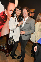 MARTINE McCUTCHEON and JACK McMANUS at the launch of Simply Glamorous by Gary Cockerill held at Alon Fine Art, 5-7 Dover Street, London on 16th September 2015.
