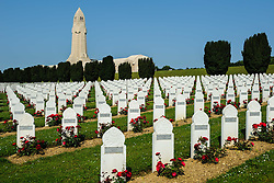 The graves of Muslim soldiers at the French Military Cemetary at Douaumont, Verdun, France.  The ossuary  containing the remains of soldiers who died on the battlefield during the Battle of Verdun in World War I can be seen in the background.<br /> <br /> (c) Andrew Wilson | Edinburgh Elite media