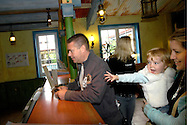 Visitors check in and relax in the Splash Landings Hotel, Alton Towers, UK..Photo©Steve Forrest/Workers' Photos..