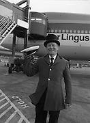 At Dublin Airport..1982.30.09.1982..09.30.1982.30th September 1982..The Taoiseach Mr Charles Haughey greeted Senior Captain of 747's Mr Jock Armstrong at the conclusion of his last flight. Among those there to greet him were Mr Niall Weldon, Company Secretary, Aer Lingus, Mr David Kennedy,CEO,Aer Lingus and members of the Meath Hunt where Mr Armstrong is Joint Secretary..Mr Haughey congratulates Captain Armstrong.