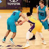 28 February 2017: Charlotte Hornets guard Nicolas Batum (5) drives past Los Angeles Lakers forward Larry Nance Jr. (7) on a screen set by Charlotte Hornets center Cody Zeller (40) during the Charlotte Hornets 109-104 victory over the LA Lakers, at the Staples Center, Los Angeles, California, USA.