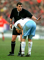Ronny Johnsen (Villa) is watched over by Referee Mr P.Dowd after getting a thigh injury. Charlton Athletic v Aston Villa. 22/2/2003. Credit : Colorsport/Andrew Cowie.