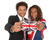 Brlack British people holding up Union jack mugs isolated on white.