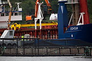 Bags of feed are lifted from the hold of the Norwegian-registered Eidholm, a ship supplying feed to salmon farms on the west coast of Scotland.<br /> <br /> Photograph © Colin McPherson, 2019 all rights reserved