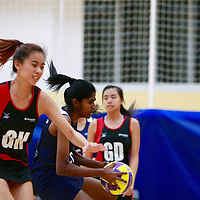 TP (red/black) defeated NYP 67-21 to remain undefeated in the POL-ITE Netball Championship. (Photo © Les Tan/Red Sports)