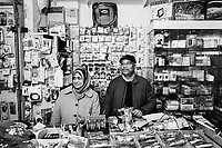 """PALERMO, ITALY - 18 JANUARY 2019: Uddin Mohammed Siraj (60, right) and his wife, from Bangladesh, pose for a portrait in his shop in the Ballarò market in Palermo, Italy, on January 18th 2019.<br /> <br /> In May 2016 of this year, ten mafia-linked criminals with ties to the Rubino family were arrested for harassing migrants and demanding payment of """"pizzo""""(protection) money. Addiopizzo, an anti-mafia movement founded by university graduates in 2004, supported the Bangladeshi stallholders in getting these mafiosi arrested.<br /> <br /> The historic market Ballarò of Palermo, in the neighbourhood known as Albergheria, is the oldest and biggest among the markets of the city.<br /> For about half a century, after World War II, Ballarò was increasingly depopulated as families moved to airier suburbs. Today there are over 14 ethnicities in Ballarò and more than 25 languages spoken: migrant communities, students, professionals, historic merchants and new entrepreneurs coexist."""