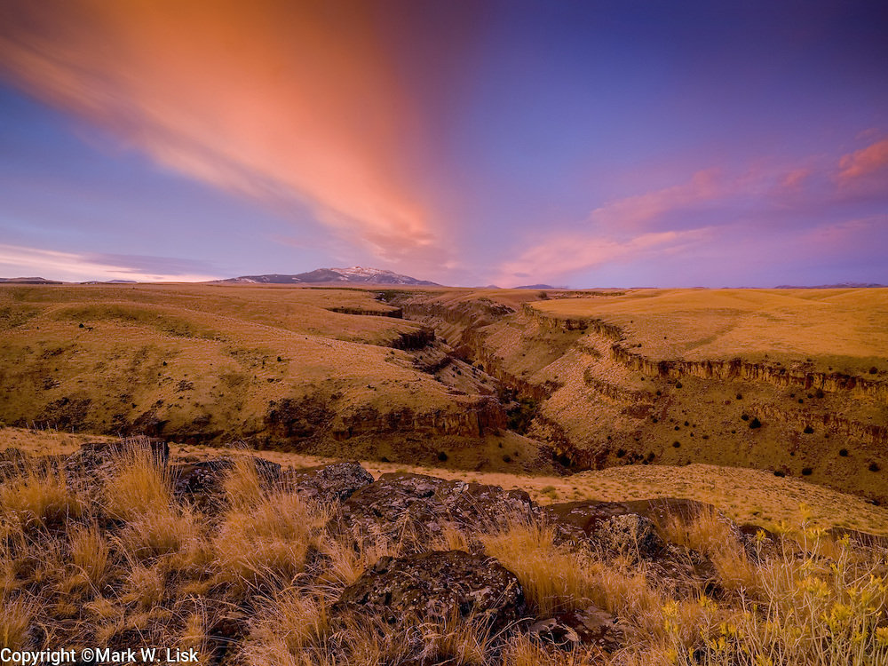 Sunrise fills the sky and canyon walls of the Jarbidge River, Owyhee Canyonlands, on the Idaho Nevada border.