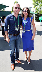 Chris Hoy and wife Sarra arriving  for the Men's Final at the Wimbledon Tennis Championships in  London, Sunday, 7th July 2013<br /> Picture by Stephen Lock / i-Images