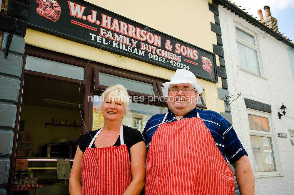 W.J. Harrison Butchers celebrate 50 years of business this year, Kilham village East Yorkshire. Pictures Hillary Windass and owner Peter Harrison. Peter is holding a Hog Roast in the village on 11 September 2010.