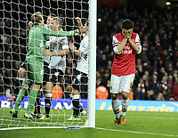 Football - Premier League - Arsenal v Fulham<br />Mikel Arteta with his head in his hands after missing a last minute penalty