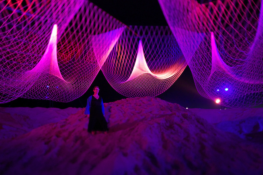 "Janet Echelman surveys her installation ""The Space Between Us"" at GLOW Santa Monica 2013"