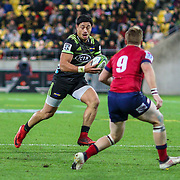 Ben Lam  runs at Ben Lucas during the Super rugby union game (Round 14) played between Hurricanes v Reds, on 18 May 2018, at Westpac Stadium, Wellington, New  Zealand.    Hurricanes won 38-34.