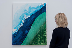"© Licensed to London News Pictures. 07/06/2016. London, UK.   A staff member views ""Crashing Wave"", by the American artist Mary Heilmann, which is previewed ahead of her first major UK exhibition, ""Looking at Pictures"", at the Whitechapel Gallery.  The exhibition spans the artist's five decade career, from her early geometric paintings made in the 1970s to her recent shaped canvases in day-glo colours.  The show features approximately 45 paintings as well as a selection of ceramics, chairs and works on paper, many of which have never been exhibited.  Photo credit : Stephen Chung/LNP"