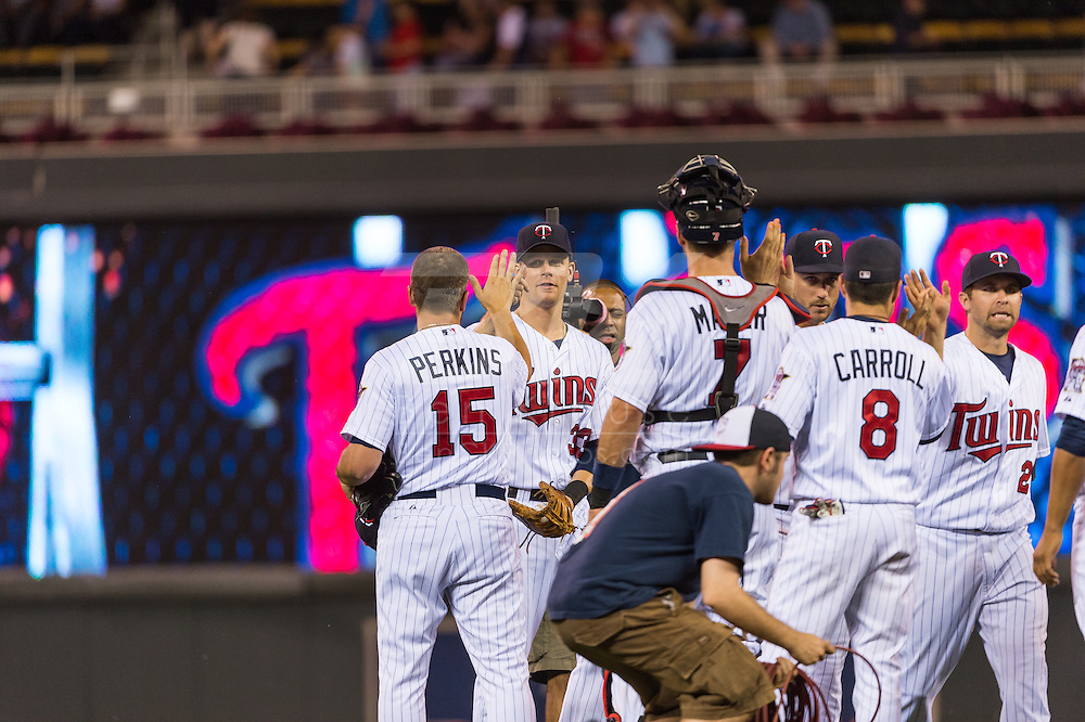 Members of the Minnesota Twins celebrate after defeating the Kansas City Royals on June 27, 2013 at Target Field in Minneapolis, Minnesota.  The Twins defeated the Royals 3 to 1.  Photo by Ben Krause