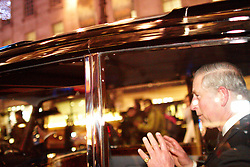 © under license to London News Pictures. 09/12/2010.  Prince Charles waves as a mob surrounds the Royal Convoy in Regent Street after it is accidentally driven into the middle of a riot. A rioter physically attacks his wife Camilla, Duchess of Cornwall, through an open window. The Rolls Royce carrying the couple is splattered with paint and a window is smashed. Photo credit should read Cliff Hide/LNP.