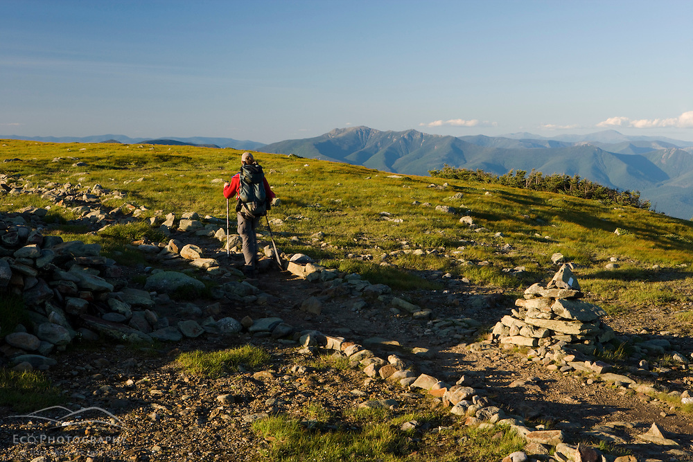 A hiker on the Appalachian Trail on the summit of Mount Moosilauke in New Hampshire's White Mountains.  Benton, New Hampshiire.
