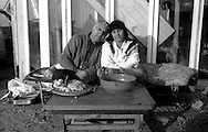 Rome October 1999.Husband and wife in front of their residencer, rom Romanian, in the Rom's camp  Casilino 700.