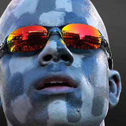 PHILADELPHIA - DECEMBER 12: An Army Cadet watches the game as the field is reflected in his glasses during the game against the Navy Midshipmen on December 12, 2009 at Lincoln Financial Field in Philadelphia, Pennsylvania. Navy won 17-3. (Photo by Drew Hallowell/Getty Images)