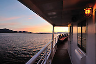 Sunrise view of the inside passage, Alaska from a small cruise ship.