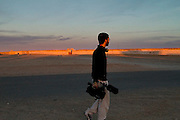 Director/Camera Saeed Taji Farouky in Samara, Algeria, during the filming of The Runner.