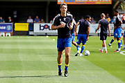 AFC Wimbledon defender Paul Robinson (6) warming up during the EFL Sky Bet League 1 match between AFC Wimbledon and Doncaster Rovers at the Cherry Red Records Stadium, Kingston, England on 26 August 2017. Photo by Matthew Redman.