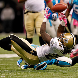 October 3, 2010; New Orleans, LA, USA; New Orleans Saints running back Chris Ivory (29) fumbles after being hit by Carolina Panthers cornerback Richard Marshall (31) during the second quarter at the Louisiana Superdome. Mandatory Credit: Derick E. Hingle