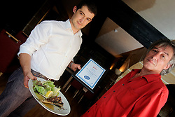 UK ENGLAND HASTINGS 6JUL06 - Pizarro chef Joel Laroix (R) and restaurant owner Sergio Guerreiro pose with a dish of grilled Mackerel at the restaurant's newly refurbished dining room. ..jre/Photo by Jiri Rezac / WWF UK..© Jiri Rezac 2006..Contact: +44 (0) 7050 110 417.Mobile:  +44 (0) 7801 337 683.Office:  +44 (0) 20 8968 9635..Email:   jiri@jirirezac.com.Web:    www.jirirezac.com..© All images Jiri Rezac 2006 - All rights reserved.