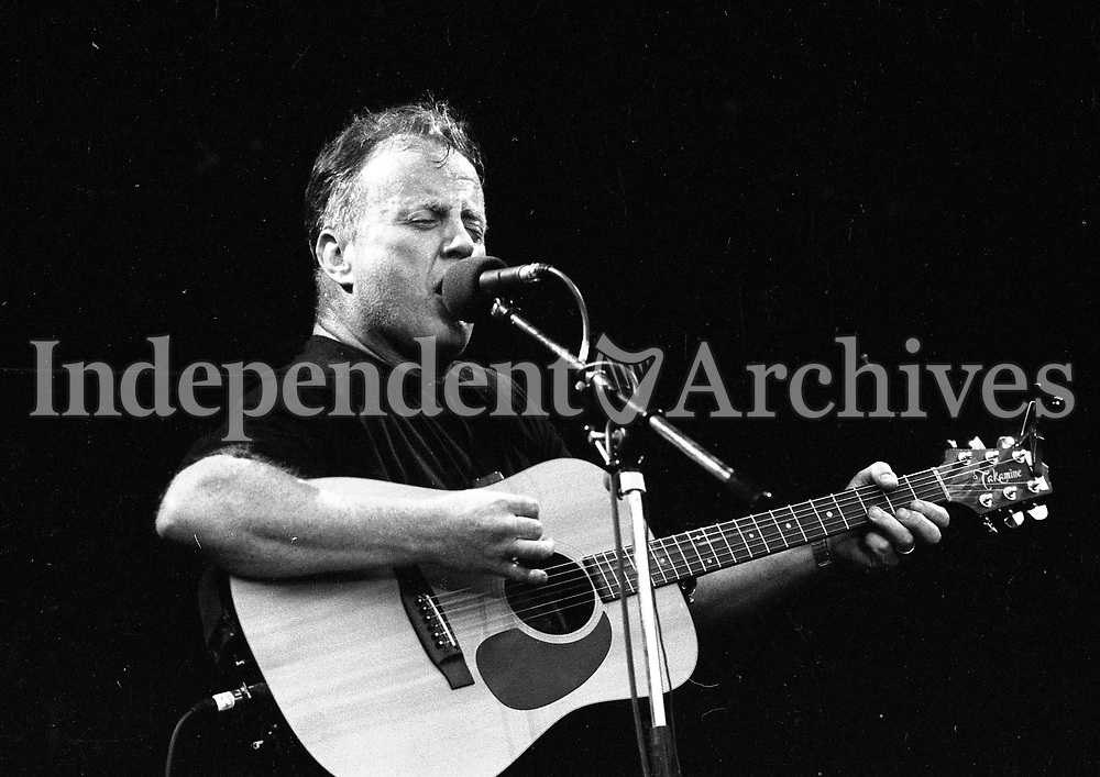 Christy Moore on stage at the Feile Festival in Thurles, Tipperary, 02/08/1992 (Part of the Independent Newspapers Ireland/NLI Collection).