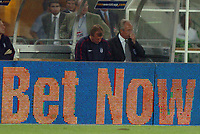 """Photo: Richard Lane.<br /> England v Austria. World Cup Qualifying Match at Ernst-Happel Stadium, Vienna. 04/09/2004.<br /> The England management under pressure....""""Bet Now"""" for how much longer<br /> NORWAY ONLY"""