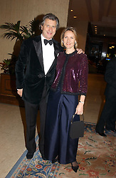 MR & MRS ARNAUD BAMBERGER he is MD of Cartier UK at the Conde Nast Traveller magazine Tsunami Appeal Dinner at the Four Seasons Hotel, Hamilton Place, London W1 on 2nd March 2005.<br />