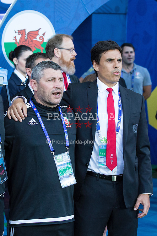 TOULOUSE, FRANCE - Monday, June 20, 2016: Wales manager Chris Coleman and assistant manager Osian Roberts sing the National Anthem ahead of the final Group B UEFA Euro 2016 Championship match against Russia at Stadium de Toulouse. (Pic by Paul Greenwood/Propaganda)