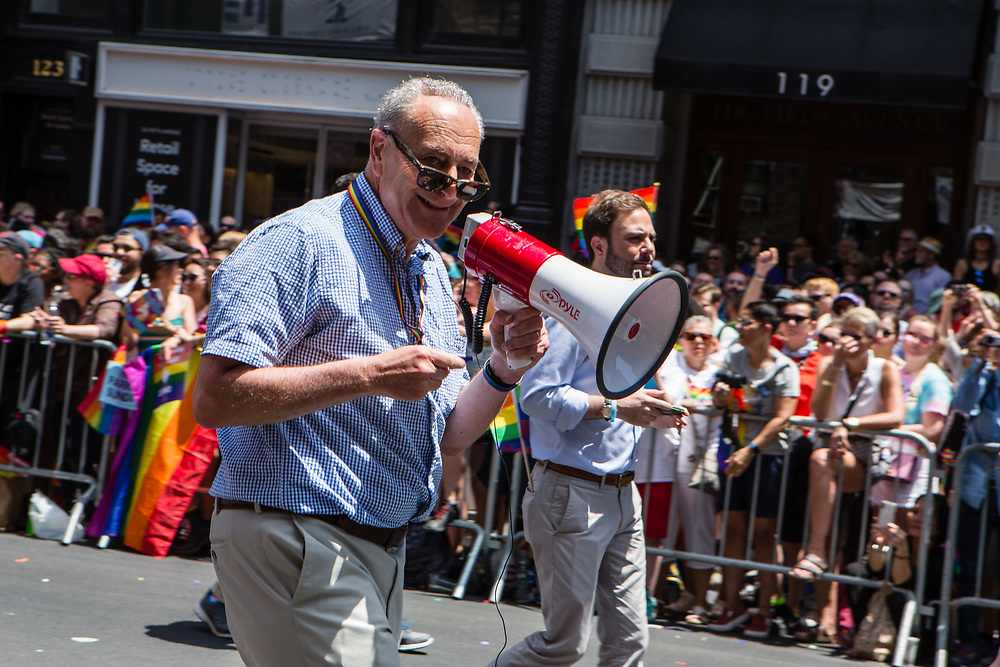 New York, NY - 30 June 2019. The New York City Heritage of Pride March filled Fifth Avenue for hours with participants from the LGBTQ community and it's supporters. New York's Senator Chuck Schumer walked the march with a bullhorn.