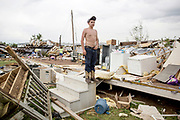 Brandon Atchley, 15, surveys the devastation at his aunt's house in Athens, Alabama. Numerous homes were destroyed when a tornado ripped through the region. (The New York Times)