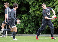 © Andrew Fosker / Seconds Left Images 2010 - Chris Ashton (R)  passes to Ben Foden  -  England Rugby Training - Pennyhill Park Hotel - 02/11/10 - Bagshot - UK - All Rights Reserved
