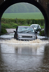 © London News Pictures. 29/04/2012. Ingatestone, UK. A  Range Rover driving through flood water on a road near the town of Ingateston in Essex on April 29, 2012 . The nearby river Wid broke it's banks following torrential rainfall. Photo credit : Ben Cawthra /LNP