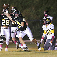 Lauren Wood | Buy at photos.djournal.com<br /> Pontotoc's Trevor Morgan holds up the ball after intercepting it in the end zone during Friday night's game against Itawamba.
